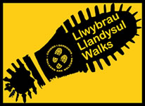 Llandysul WAW logo. Black walking boot print on yellow background