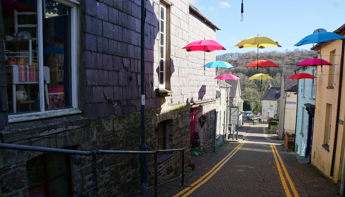 Looking down Lon Wesley Llandysul at the colour umbrella canopy. Ceredigion.